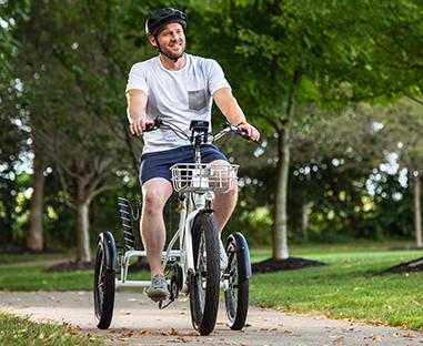 Man riding Buzz's e-trike through the park