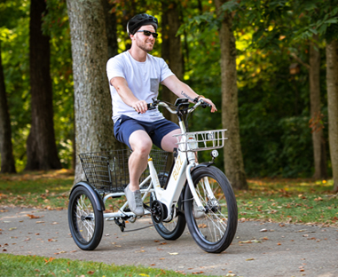 Adult with sunglasses riding an electric trike