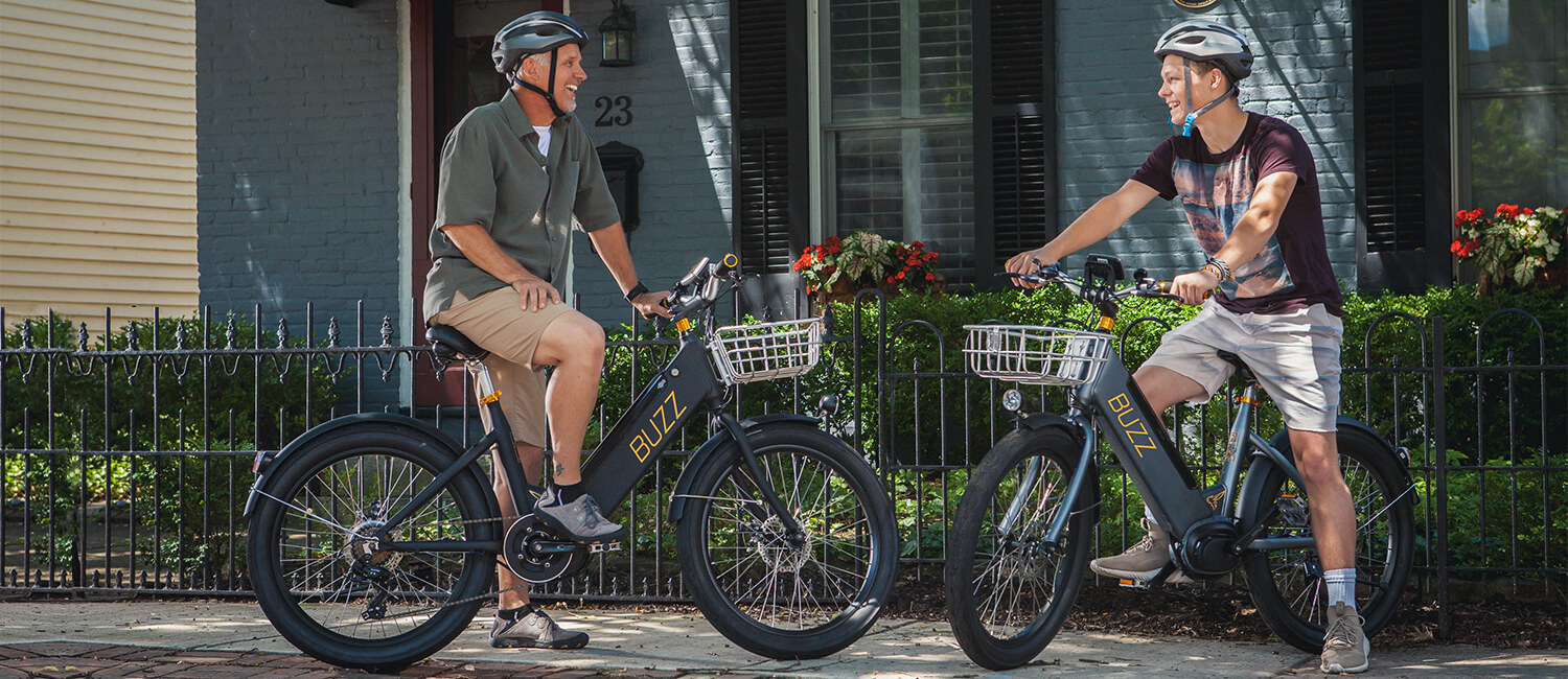 Grandfather and grandson out riding a Buzz E-Bike together